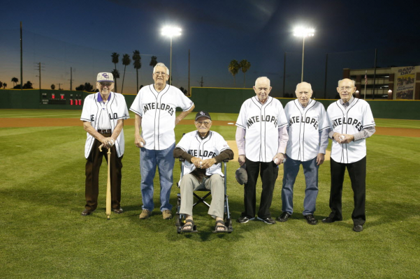 Alumni on field before a baseball game